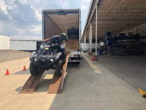 ATV hauling freight company driver Group One Transportation